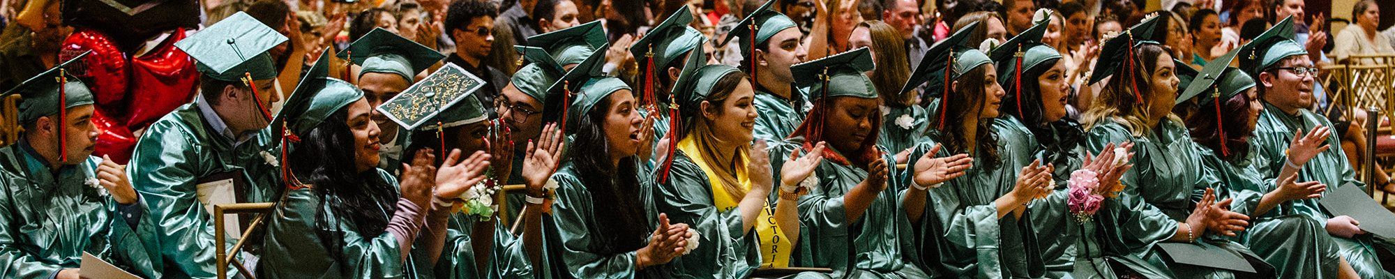 Students clapping during commencement