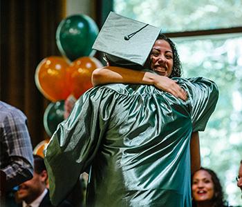 Graduating student hugging