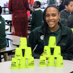 A student setting a record with cups